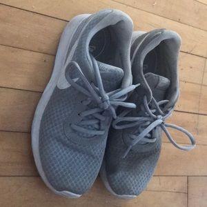 Gray Nike running shoes